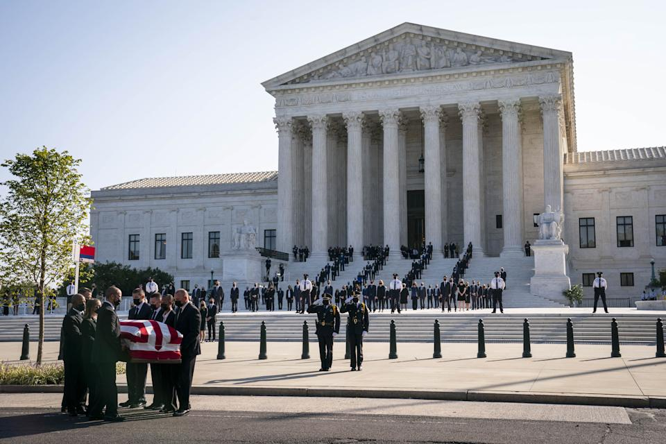 Pallbearers carry the casket of Ruth Bader Ginsburg outside the Supreme Court in Washington, D.C.