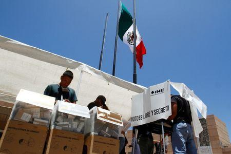Mexicans living in the U.S. cast their vote a a polling station in Tijuana, Mexico, July 1, 2018. REUTERS/Jorge Dunes