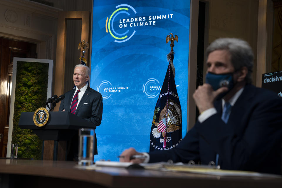 Special Presidential Envoy for Climate John Kerry listens as President Joe Biden speaks to the virtual Leaders Summit on Climate, from the East Room of the White House, Thursday, April 22, 2021, in Washington. (AP Photo/Evan Vucci)
