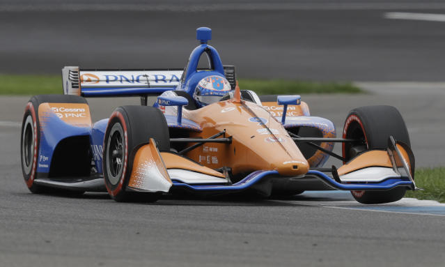 Scott Dixon, of New Zealand, steers his car during qualifications for the Indy GP IndyCar auto race at Indianapolis Motor Speedway, Friday, May 10, 2019 in Indianapolis. (AP Photo/Darron Cummings)