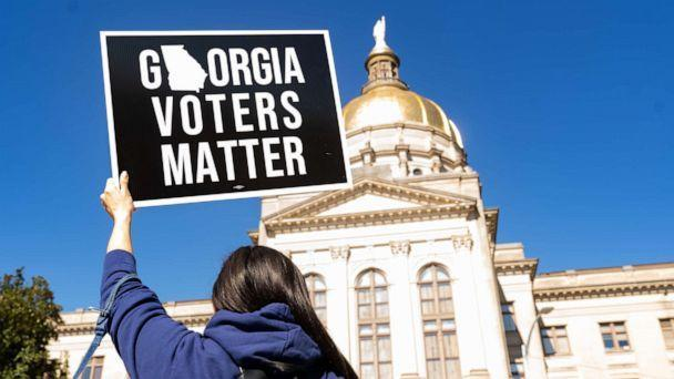 PHOTO: Demonstrators stand outside of the Georgia Capitol building, to oppose the HB 531 bill, March 3, 2021, in Atlanta. (Megan Varner/Getty Images)