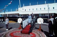 <p>Queen Elizabeth II and Prince Philip come ashore from the royal yacht Britannia to say farewell to the Amir of Kuwait and his ministers in Kuwait in 1979.</p>