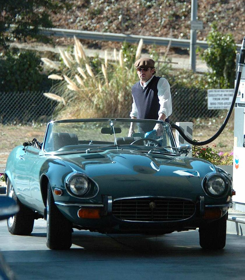 """Patrick Dempsey's cap and sunglasses go along perfectly with his classic Jag. Richard Beetham/<a href=""""http://www.splashnewsonline.com"""" target=""""new"""">Splash News</a>"""