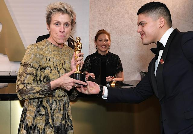 <p>The Best Actress winner got a helping hand from proud son Pedro McDormand Coen. (Photo: Angela Weiss/AFP/Getty Images) </p>