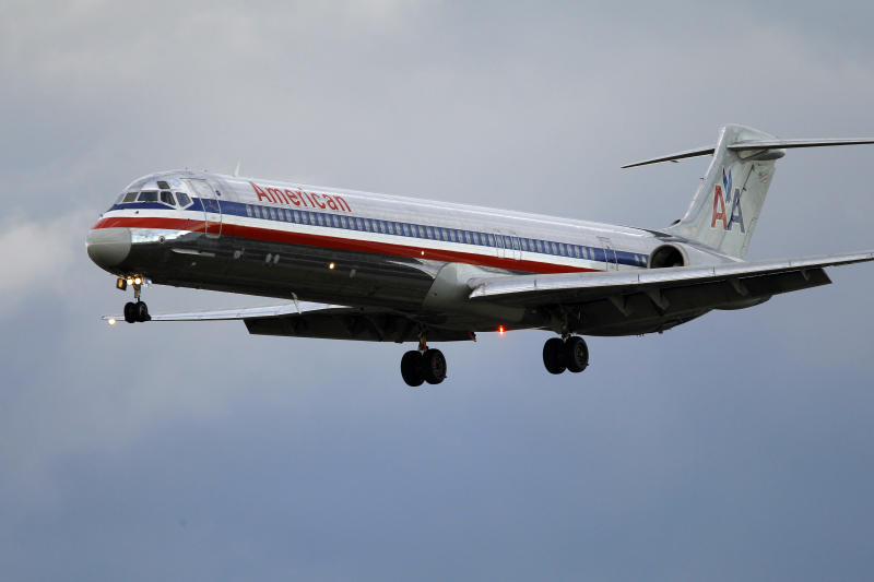 In this Oct. 29, 2010 photo, an American Airlines jet airplane approaches Philadelphia International Airport in Philadelphia. American Airlines ground workers split over the company's final contract offer that would spare some jobs targeted for elimination. The Transport Workers Union said Tuesday, May 15, 2012,  that five work groups voted to accept the company's offer but two others, including the biggest, aircraft mechanics, rejected it. Pilots, flight attendants and the TWU have already thrown their support to a bid by US Airways to take over American and create a bigger combined airline. (AP Photo/Matt Rourke)