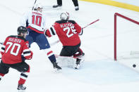Washington Capitals right wing Daniel Sprong (10) skates against New Jersey Devils goaltender Mackenzie Blackwood (29) during the first period of an NHL hockey game, Saturday, Feb. 27, 2021, in Newark, N.J. (AP Photo/Mary Altaffer)