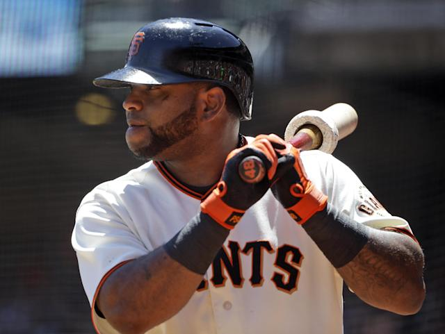 San Francisco Giants' Pablo Sandoval waits for his at-bat on deck during the first inning of a baseball game against the Miami Marlins on Sunday, May 18, 2014, in San Francisco. (AP Photo/Marcio Jose Sanchez)