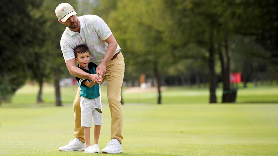 CRANS-MONTANA, SWITZERLAND - AUGUST 27: Justin Timberlake shows his son Silas how to put ahead of the Pro-Am prior to the start of the Omega European Masters at at Crans Montana Golf Club on August 27, 2019 in Crans-Montana, Switzerland.