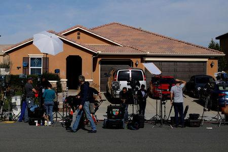 FILE PHOTO: News media gather outside the home of David Allen and Louise Anna Turpin in Perris, California, U.S., January 16, 2018. REUTERS/Mike Blake/File Photo