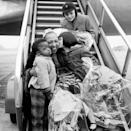 <p>After traveling for work, Josephine greets three of her children at the airport in 1954. </p>