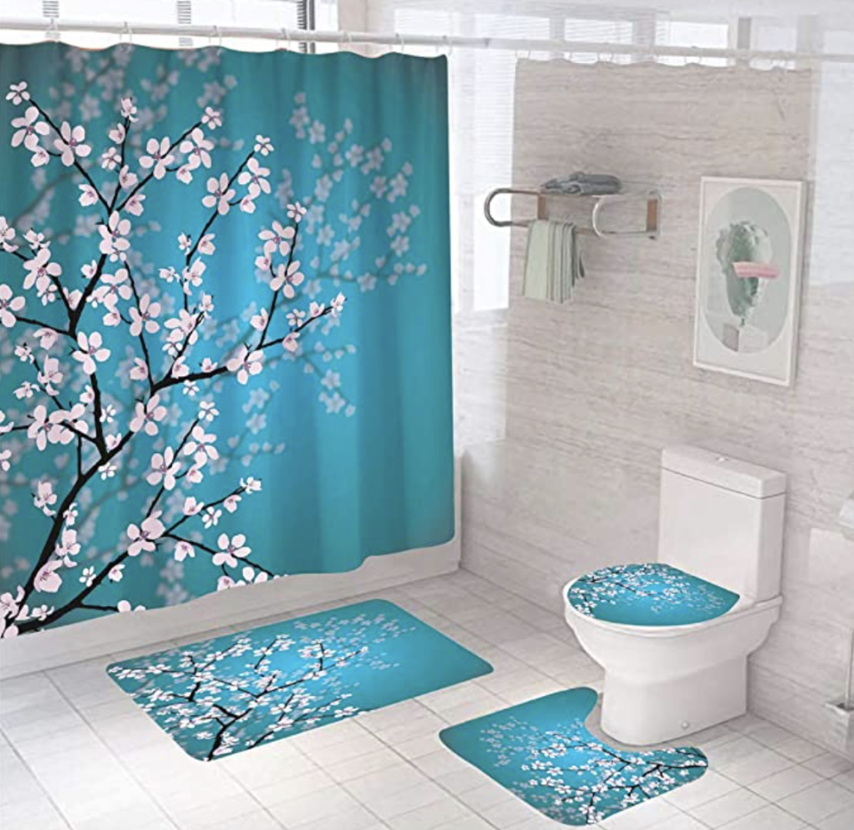 PHOTO: Amazon. Shower Curtains with Non-Slip Rugs Toilet Lid Cover, Bath Mat, Waterproof