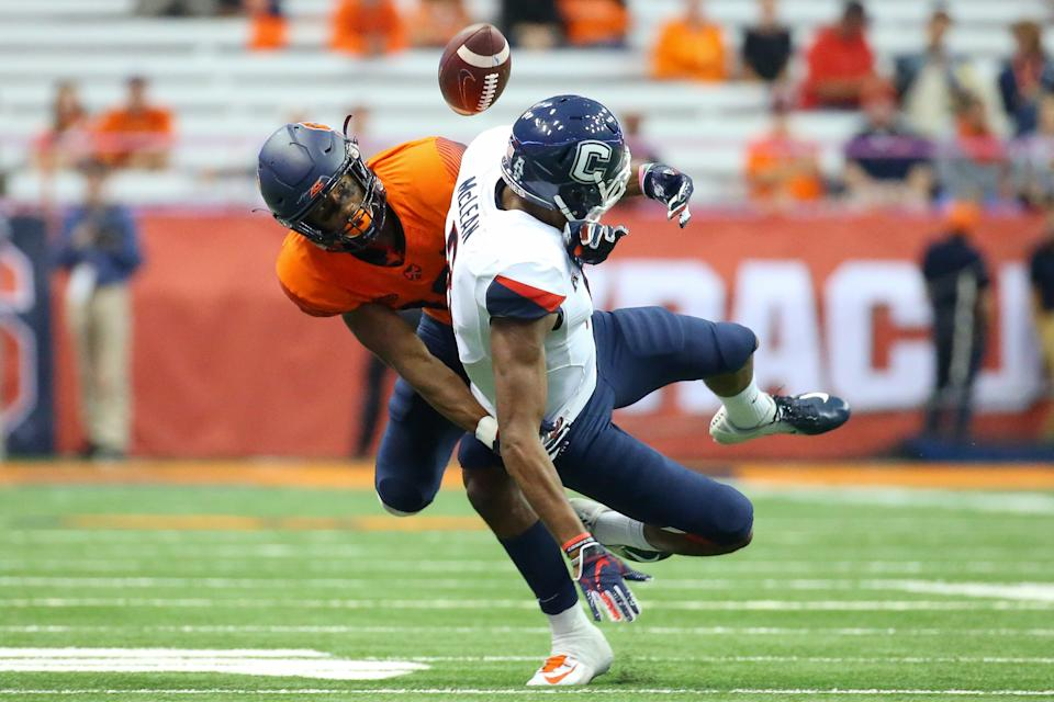 SYRACUSE, NY - SEPTEMBER 22:  Andre Cisco (back) of the Syracuse Orange breaks up a pass intended for Aaron McLean (front) of the Connecticut Huskies during the fourth quarter at the Carrier Dome on September 22, 2018 in Syracuse, New York. Syracuse defeated Connecticut 51-21. (Photo by Rich Barnes/Getty Images)