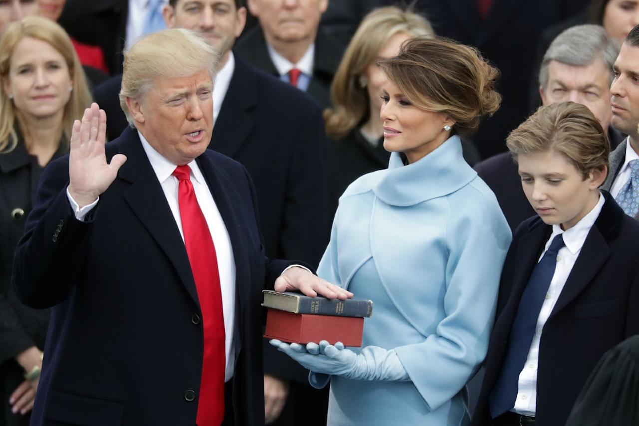 """<p>On Inauguration Day, Melania stepped out in a slim-fitting powder blue suit and suede gloves <a href=""""https://www.townandcountrymag.com/society/politics/news/a9292/what-trump-family-melania-wore-to-the-inauguration/"""" target=""""_blank"""">reminiscent of what Jackie Kennedy wore to JFK's</a> swearing in ceremony in 1961.</p>"""