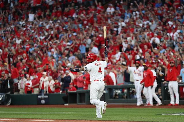 Yadier Molina celebrates his game-winning RBI against the Braves in Game 4 of the National League Division Series at Busch Stadium. (Photo by Jamie Squire/Getty Images)