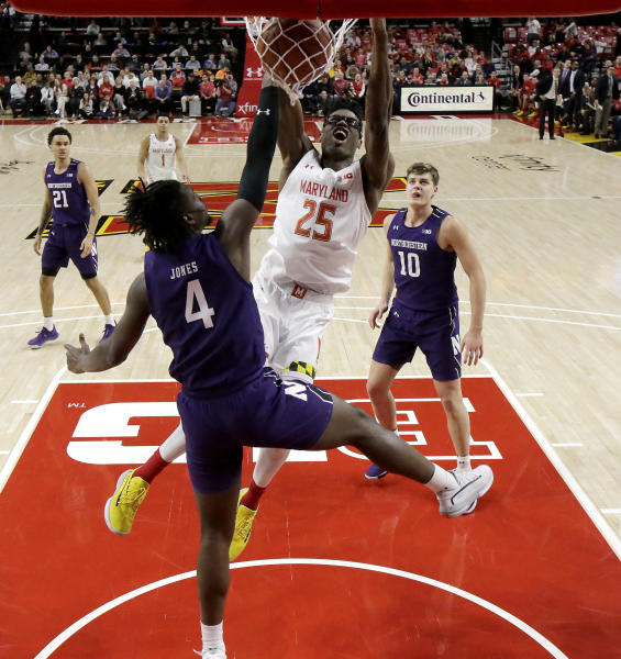 Maryland forward Jalen Smith (25) dunks on Northwestern forward Jared Jones (4) during the first half of an NCAA college basketball game, Tuesday, Feb. 18, 2020, in College Park, Md. Maryland won 76-67. (AP Photo/Julio Cortez)