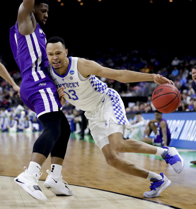 Kentucky's Jemarl Baker Jr. (13) makes a move to get past Abilene Christian's Jaylen Franklin during the first half of a first-round game in the NCAA mens college basketball tournament in Jacksonville, Fla. Thursday, March 21, 2019. (AP Photo/John Raoux)