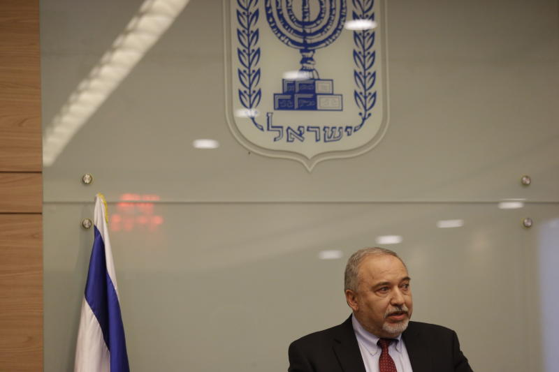 Israeli Defense Minister Avigdor Lieberman delivers a statement at the Knesset, Israel's Parliament, Wednesday, Nov. 14, 2018. Lieberman announced his resignation Wednesday over the Gaza cease-fire, making early elections likely. (AP Photo/Ariel Schalit)
