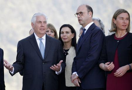 U.S. Secretary of State Rex Tillerson gestures as he talks with Italy's Foreign Minister Angelino Alfano and E.U. High Representative for Foreign Affairs Federica Mogherini during a ceremony at the Sant'Anna di Stazzema memorial