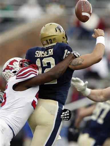 SMU linebacker Ja'Gared Davis (56) sacks Pittsburgh quarterback Tino Sunseri (12) causing a fumble in the first half of the BBVA Compass Bowl NCAA college football game on Saturday, Jan. 7, 2012, in Birmingham, Ala. (AP Photo/Butch Dill)