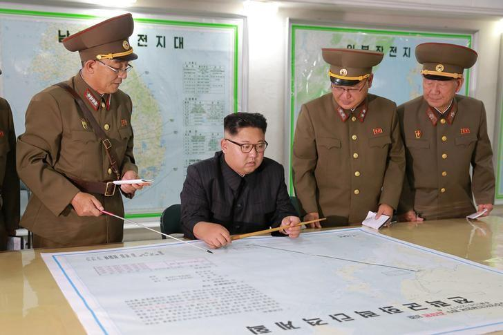 North Korean leader Kim Jong Un is shown plans on a proposed military strike on Guam (Reuters)