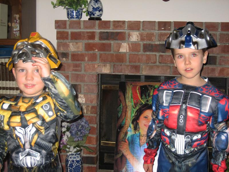 FILE - This undated file photo provided by Chuck and Judy Cox shows Braden, left, and Charlie Powell. The family of missing Utah woman Susan Powell is holding a public funeral for her two sons, Braden and Charlie, nearly a week after their father killed them in a gas-fueled blaze. Hundreds of people are attending the service Saturday, Feb. 11, 2012, at Life Center Church in Tacoma, Wash. Many are wearing purple and blue ribbons in memory of 7-year-old Charlie and 5-year-old Braden. (AP Photo/Courtesy Chuck and Judy Cox, File)