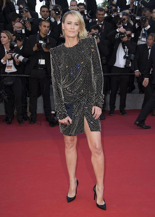 <p>While most other attendess opted for gowns, Robin Wright stood out in a rocker-chic minidress from Saint Laurent. (Photo: AP) </p>