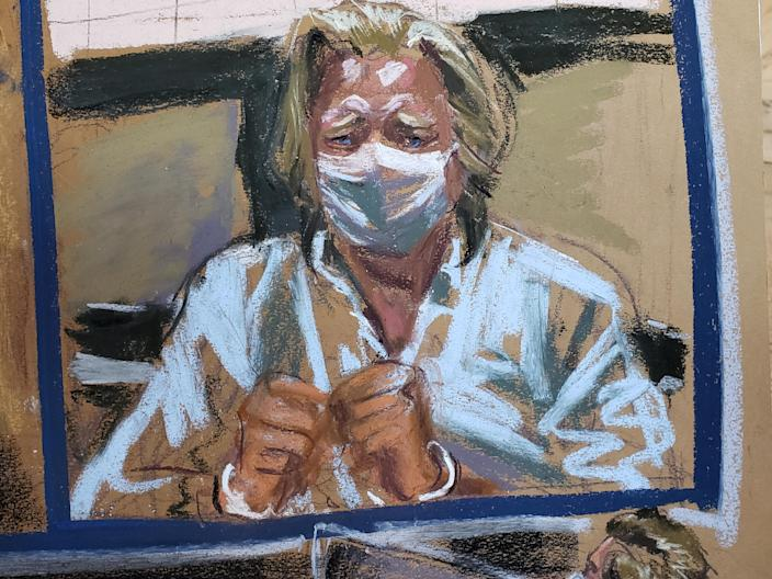 A courtroom sketch shows Bannon, handcuffed and wearing a mask, during his arraignment on Thursday inside Federal District Court in Manhattan. (Jane Rosenberg/Reuters)
