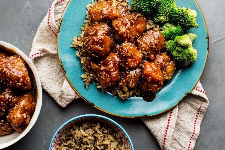 """<p>Crispy chicken underneath a sticky and sweet honey sauce? Served with rice, you'll never need takeout again!</p><p>Get the <a href=""""https://www.delish.com/uk/cooking/recipes/a29559363/crispy-honey-sesame-chicken-recipe/"""" rel=""""nofollow noopener"""" target=""""_blank"""" data-ylk=""""slk:Crispy Honey Sesame Chicken"""" class=""""link rapid-noclick-resp"""">Crispy Honey Sesame Chicken</a> recipe.</p>"""