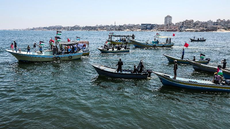 Activists escort a boat carrying wounded Palestinians from Gaza in a bid to challenge an Israeli blockade of the enclave on July 10, 2018