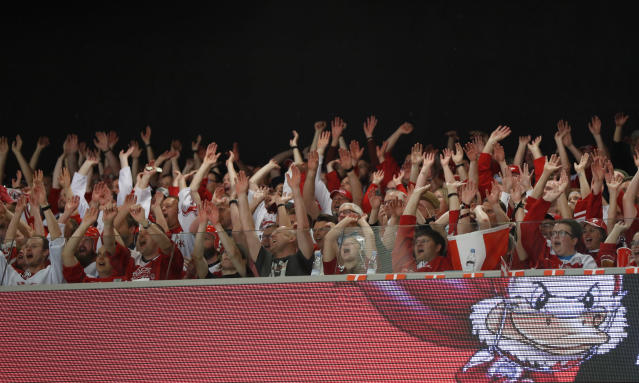 Fans cheer during the Ice Hockey World Championships group B match between Denmark and Latvia at the Jyske Bank Boxen arena in Herning, Denmark, Tuesday, May 15, 2018. (AP Photo/Petr David Josek)