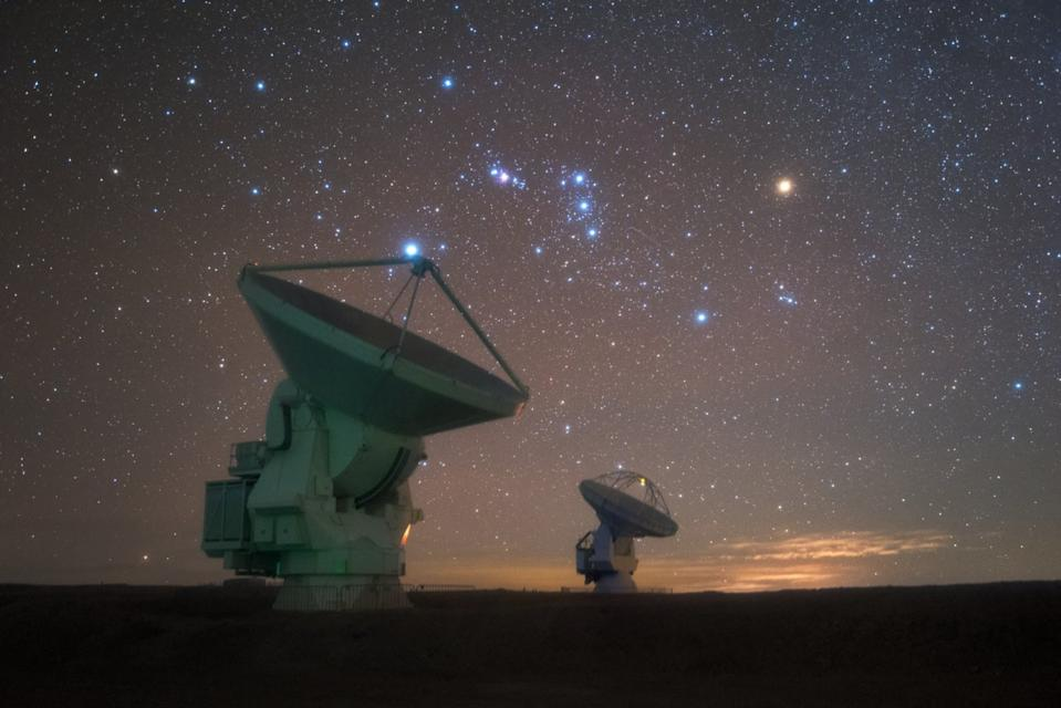The constellation of Orion, the hunter sparkles above the  Atacama Large Millimeter/submillimeter Array (ALMA) in Chile's Atacama Desert in this image by European Southern Observatory photo ambassador Yuri Beletsky. Two of the 66 radio telescopes that make up the array are shown in this view. Located on top of the 16,000-foot (5,000 meters) Chajnantor plateau, ALMA's location provides the dark, dry skies that are crucial for observing the cosmos in millimeter and submillimeter wavelengths.