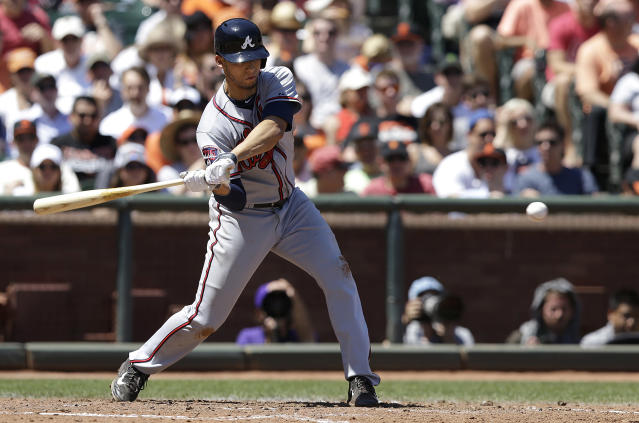 Atlanta Braves' Andrelton Simmons hits a triple off of San Francisco Giants pitcher Madison Bumgarner to score Chris Johnson during the fourth inning of a baseball game in San Francisco, Wednesday, May 14, 2014. (AP Photo)