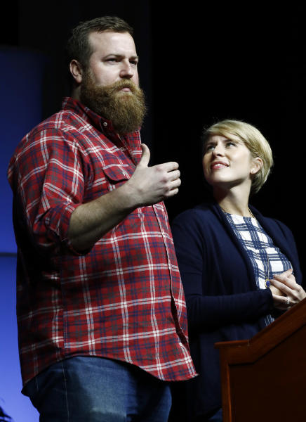 "Ben Napier, left, and his wife Erin, from the HGTV home renovation series, ""Home Town,"" based in their hometown of Laurel, Miss., speaks at a spring meeting luncheon of the Mississippi Economic Council, Thursday, April 27, 2017, in Jackson, Miss. The couple encouraged small businesses to invest in their communities in order to make a positive impact. (AP Photo/Rogelio V. Solis)"
