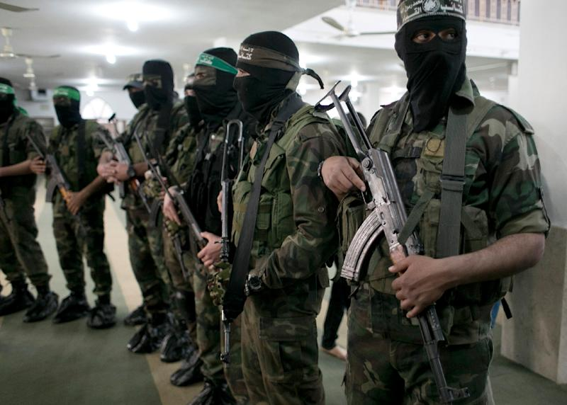 Members of the Ezzedine al-Qassam Brigades, the military wing of the Palestinian Islamist movement Hamas, at attention in the southern Gaza Strip on March 4, 2016
