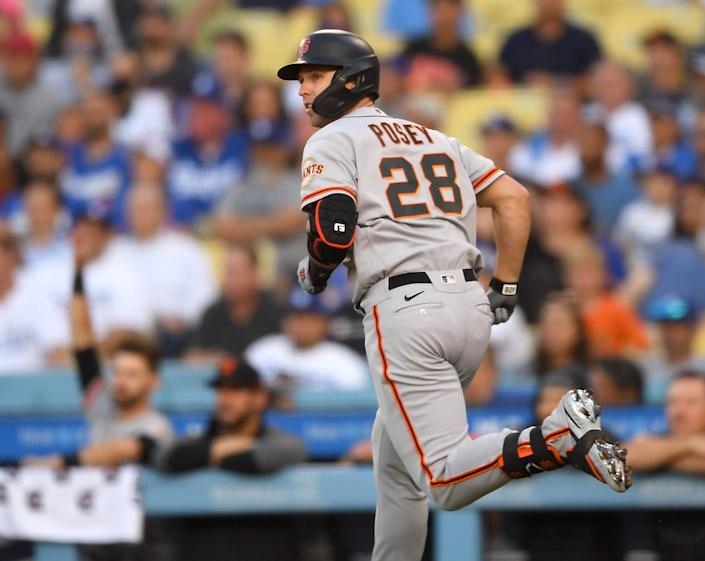 Buster Posey rounds the bases after hitting a homer against the Dodgers on July 19.