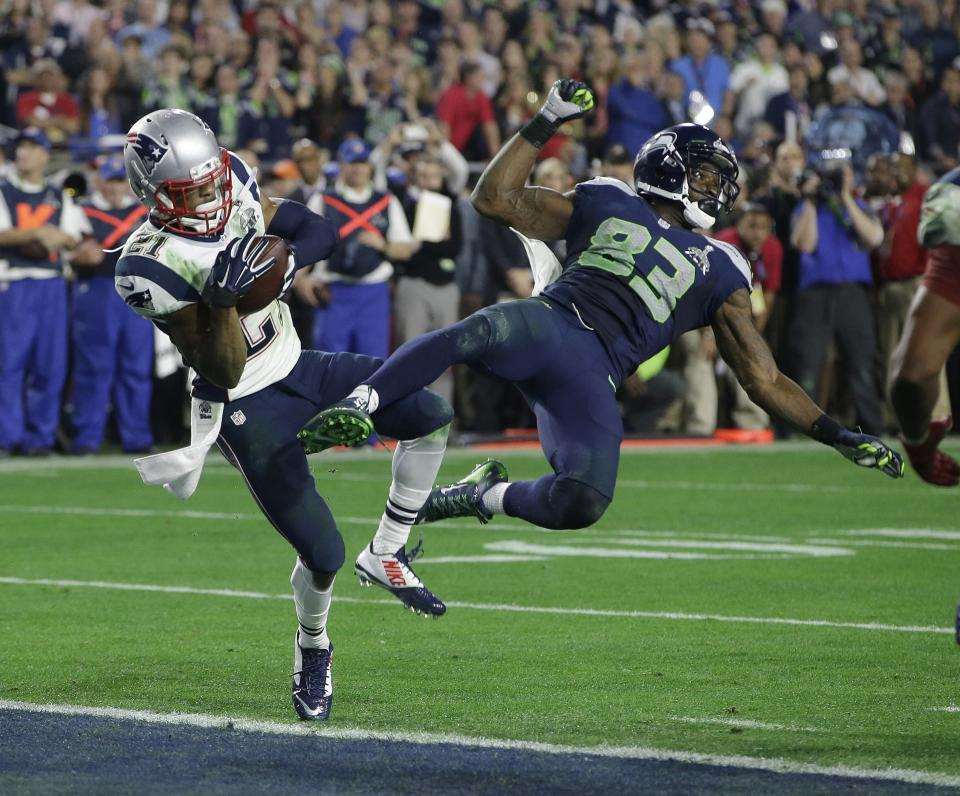 """FILE - New England Patriots strong safety Malcolm Butler (21) intercepts a pass intended for Seattle Seahawks wide receiver Ricardo Lockette (83) during the second half of NFL Super Bowl XLIX football game Sunday, Feb. 1, 2015, in Glendale, Ariz. Butler was an """"invited tryout"""" player who got his chance in May of 2014. Nine months later, his first career interception saved the Super Bowl for the Patriots when he dug inside Seahawks receiver Ricardo Lockette to pick off Russell Wilson's pass from the 1 with 20 seconds remaining to preserve New England's 28-24 win. (AP Photo/Kathy Willens, File)"""