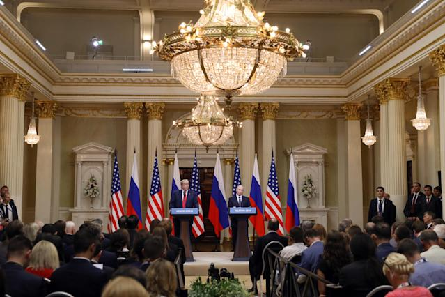 <p>U.S. President Donald Trump, left, listens as Vladimir Putin, Russia's President, speaks during a news conference in Helsinki, Finland, on Monday, July 16, 2018. (Photo: Chris Ratcliffe/Bloomberg via Getty Images) </p>