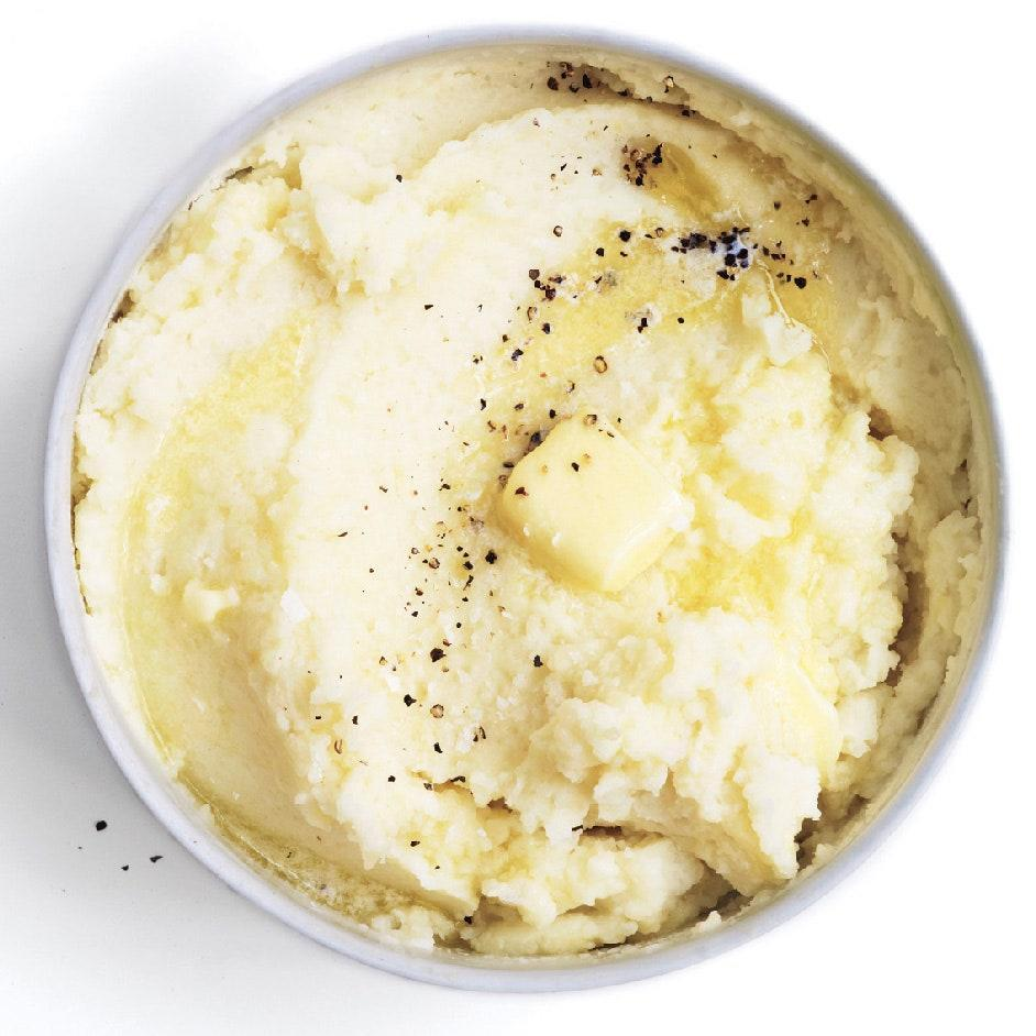 """The tang of sour cream gives the illusion that this recipe is not as rich as the cream, butter, <em>and</em> milk would imply. <a href=""""https://www.epicurious.com/recipes/food/views/sour-cream-mashed-potatoes-51198930?mbid=synd_yahoo_rss"""" rel=""""nofollow noopener"""" target=""""_blank"""" data-ylk=""""slk:See recipe."""" class=""""link rapid-noclick-resp"""">See recipe.</a>"""