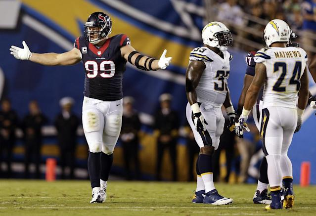 FILE - In this Sept. 8, 2013, file photo, Houston Texans defensive end J.J. Watt, left, reacts after making a stop on the San Diego Chargers during the first half of an NFL football game in San Diego. Tennessee Titans right guard Chance Warmack has been hearing about Watt since he was a junior at Alabama. Now the Titans rookie gets his first chance to try to slow down the quarterback-sacking, pass-swatting Watt when Tennessee visits the Texans on Sunday.(AP Photo/Gregory Bull, File)
