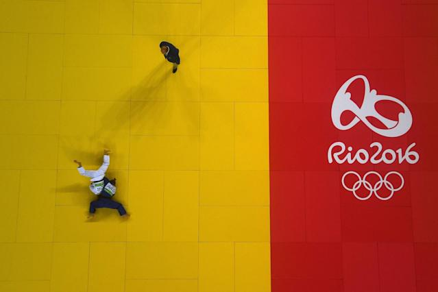 <p>Paula Pareto of Argentina (blue) competes against Bokyeong Jeong of Korea in the Women's -48 kg Gold Medal contest on Day 1 of the Rio 2016 Olympic Games at Carioca Arena 2 on August 6, 2016 in Rio de Janeiro, Brazil. (Photo by Laurence Griffiths/Getty Images) </p>