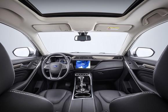A view of the Territory's front seats and dashboard, with a large touchscreen system visible.