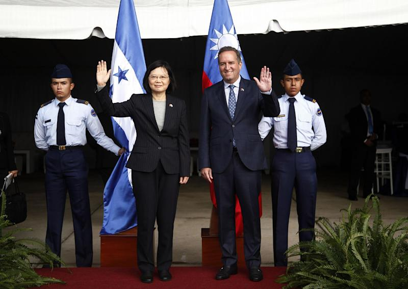 Taiwan's President Tsai Ing-wen, left, and First Vice President of Honduras Ricardo Alvarez, wave during a welcome ceremony after Tsai's arrival at Soto Cano Air Base outside Comayagua, Honduras, Sunday, Jan. 8, 2017. The Taiwanese leader will meet with Honduran President Juan Orlando Hernandez on Monday, as part of a weeklong state tour to reinforce Taiwanese relations with Honduras, Guatemala, El Salvador, and Nicaragua. (AP Photo/Fernando Antonio)
