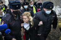 Police officer detain the Alliance of Doctors union's leader Anastasia Vasilyeva at the prison colony IK-2, which stands out among Russian penitentiary facilities for its particularly strict regime, in Pokrov in the Vladimir region, 85 kilometers (53 miles) east of Moscow, Russia, Tuesday, April 6, 2021. Doctors from the Navalny-backed Alliance of Doctors announced going to the Pokrov prison on Tuesday to demand the opposition leader gets qualified medical help from independent doctors after he complained about pain in his leg and back. (AP Photo/Pavel Golovkin)