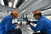 JINAN, March 31, 2020 -- Workers assemble automation equipment at a plant of Jier Machine-Tool Group Co., Ltd in Jinan, east China's Shandong Province, March 31, 2020. Due to the COVID-19 outbreak, the enterprise had to adjust its production process for the lack of purchased parts. Nonetheless, over 5,000 staff members have committed to their work to ensure the orderly production resumption. (photo by Zhu Zheng/Xinhua via Getty) (Xinhua/Zhu Zheng via Getty Images)