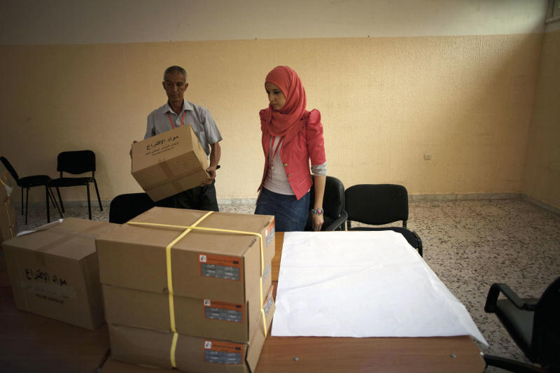 Libyan election officials work at a polling station in Tripoli, Libya, Friday, July 6, 2012. The Libyan National Assembly elections - the first free election since 1969-will take place on July 7, 2012. (AP Photo/Manu Brabo)