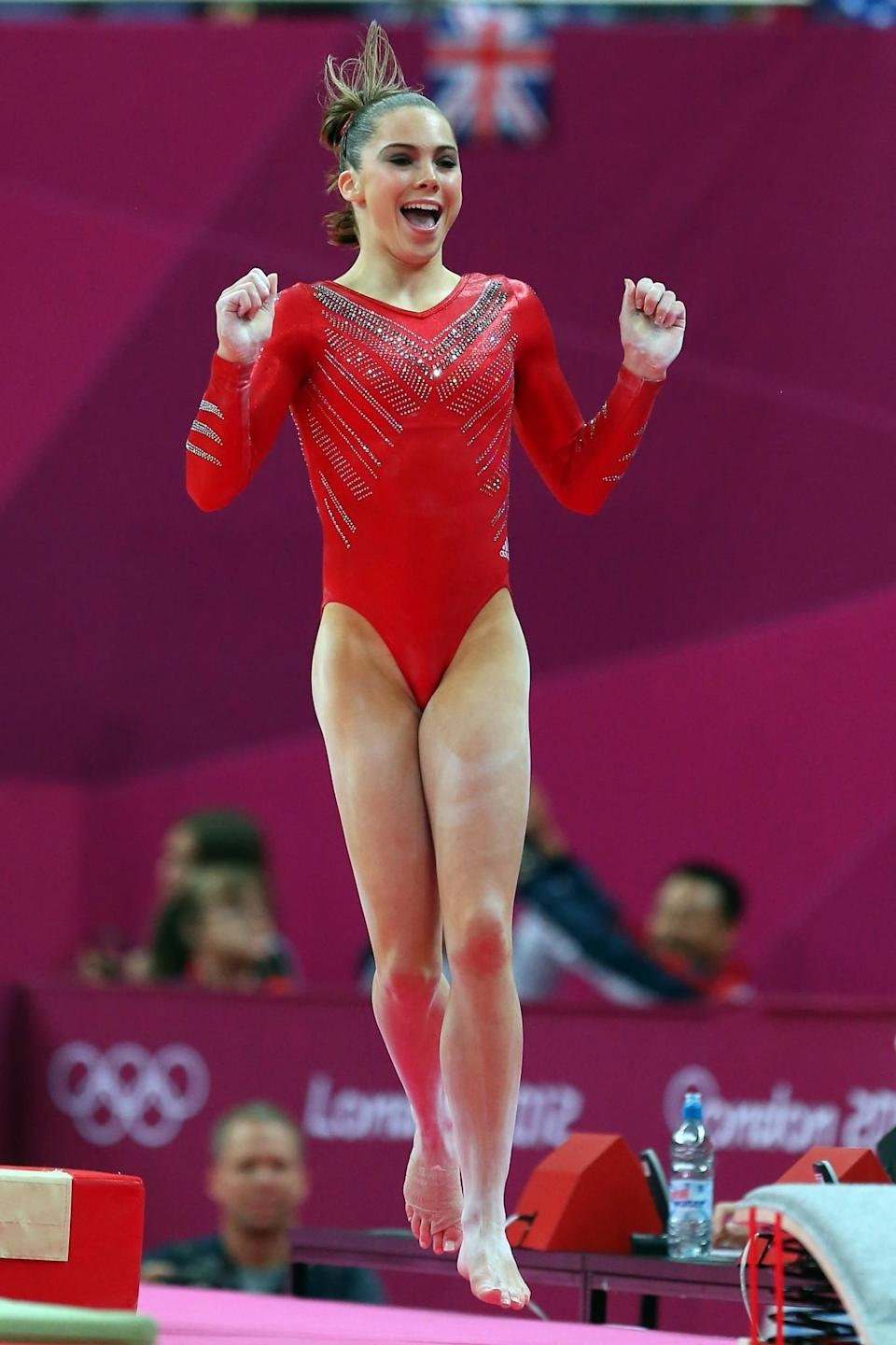 <p>McKayla Maroney Maroney of the United States of America celebrates her performance on the vault in the Artistic Gymnastics Women's Team final on Day 4 of the London 2012 Olympic Games at North Greenwich Arena on July 31, 2012 in London, England. (Photo by Ronald Martinez/Getty Images) </p>