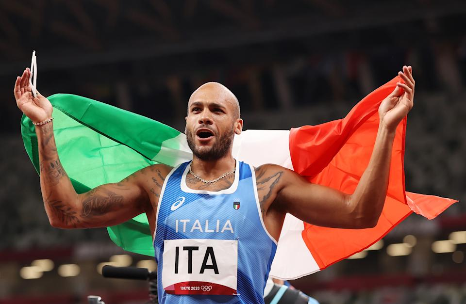 TOKYO, JAPAN - AUGUST 06: Lamont Marcell Jacobs of Team Italy celebrates winning the gold medal in the Men's 4 x 100m Relay Final on day fourteen of the Tokyo 2020 Olympic Games at Olympic Stadium on August 06, 2021 in Tokyo, Japan. (Photo by David Ramos/Getty Images)