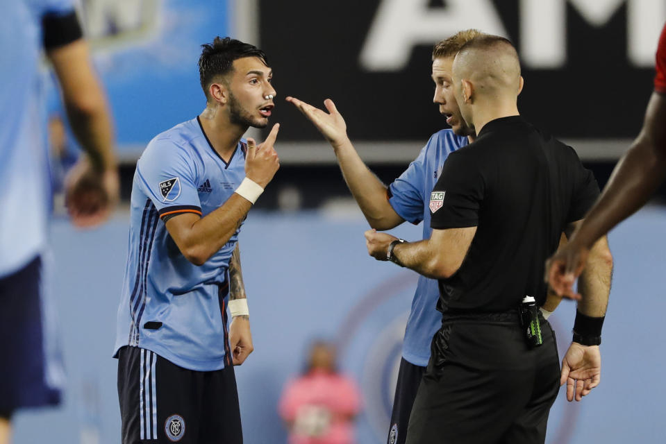 New York City FC's Valentin Castellanos, left, argues with a referee after being injured during the second half of an MLS soccer match against Toronto FC Wednesday, Sept. 11, 2019, in New York. The game ended in a 1-1 draw. (AP Photo/Frank Franklin II)