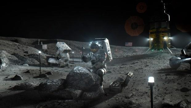 This illustration made available by NASA in April 2020 depicts Artemis astronauts on the moon. The human spaceflight program aims to land