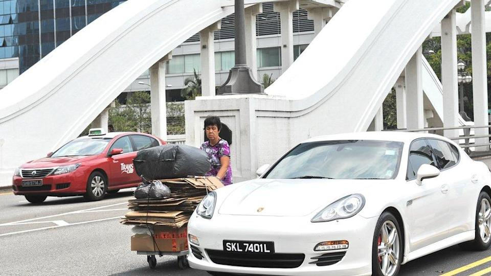 Woman waste collection sports car Singapore